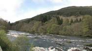 Stock Video Footage of Highland River With Forest & Hills - Scotland