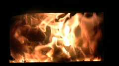 Zoom to flames flickering inside a woodburning stove Stock Footage