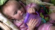 Baby drinking Stock Footage