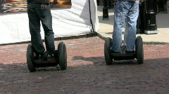 Two men play on segways  Stock Footage