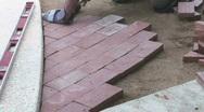 Man Levels Bricks Stock Footage