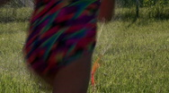 Kids Running through Sprinkler Stock Footage