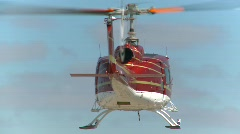 Aircraft, huey helicopter hover, #5 near hangars Stock Footage