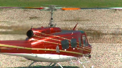 Aircraft, huey helicopter, #13 on ground Stock Footage
