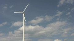 Single windmill against blue sky Stock Footage
