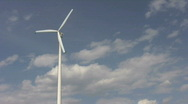Stock Video Footage of single windmill against blue sky