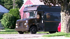 UPS Truck Driving off in Neighborhood Stock Footage