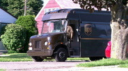 Stock Video Footage of UPS Truck Driving off in Neighborhood
