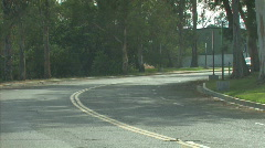 car drives around bend 1 - stock footage