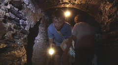 Children explore tunnel - stock footage