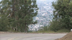 car drives around bend 2 - stock footage