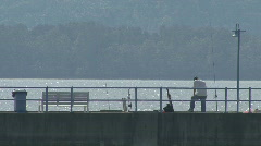 Man Fishng from a Jetty Stock Footage