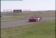 Motorsports, GT roadcourse race, Chev, Datsun and others through chicane Stock Footage