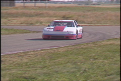 Motorsports, GT roadcourse race, follow shot GTU Oldsmobile... fast!! Stock Footage