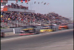 Motorsports, GT roadcourse race, great pack of cars, pan follow Stock Footage