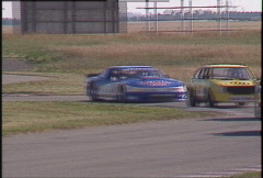 Motorsports, GT roadcourse race, through chicane, handheld. follow GTU Olds Stock Footage