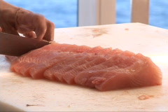 Slicing raw fish Stock Footage