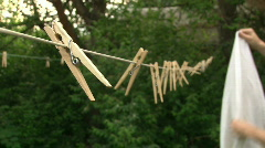 Hanging White Sheet on Clothes line Stock Footage