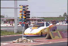 Motorsports, drag racing, top alcohol funny car pass single follow shot tight Stock Footage