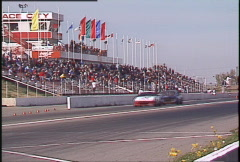 Motorsports, GT roadcourse race, front straight through frame, grandstand, hand Stock Footage