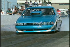 Motorsports, drag racing, supercomp burnout whip pan dramatic Stock Footage
