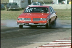 Motorsports, drag racing, Heavy ET Oldsmobile burnout Stock Footage
