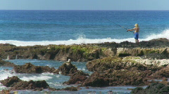 Fisherman on the Rocks Stock Footage