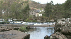 Scenic Highland River With Watermill In Distance Stock Footage