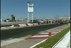 Motorsports, drag racing, Top alcohol dragster follow shot zoom Stock Footage