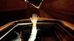 Car driving through tunnel Stock Footage