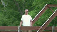 Man Waving on Bridge Stock Footage