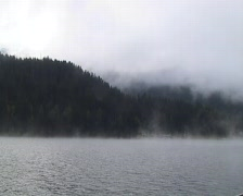 Fog over lake Davos Stock Footage