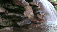 Small water fall with stacked rock - stock footage