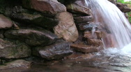 Stock Video Footage of Small water fall with stacked rock