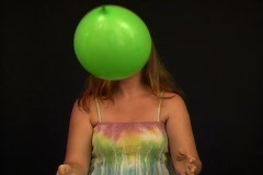 Attractive Young Woman Playing with a Green Balloon Stock Footage
