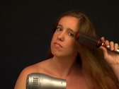 Stock Video Footage of Attractive Young Woman with Blow Dryer-2