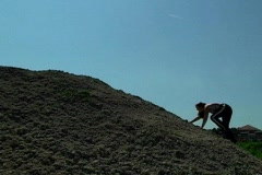 Young Woman Climbing a Hill Stock Footage