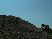 Stock Video Footage of Young Woman Climbing a Hill