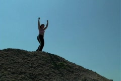 Young Woman Dances on a Hilltop Stock Footage