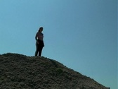 Stock Video Footage of Young Woman Dances on a Hilltop