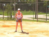 Stock Video Footage of Female Softball Player Catches a Ground Ball