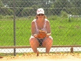 Stock Video Footage of Female Softball Player on the Bench (1)