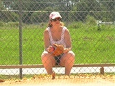 Stock Video Footage of Female Softball Player on the Bench (2)