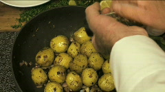 Sauteeing potatoes Stock Footage