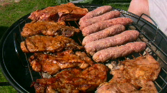 Chicken and steak cooking on a charcoal  grill  Stock Footage