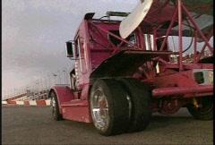 Motorsports, Big Rig racing, smoky burnout, reverse angle, wild! Stock Footage
