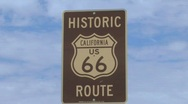 Stock Video Footage of Route 66 Sign with Clouds