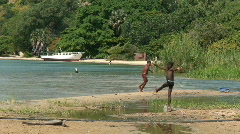 Malawi: african children playing in water Stock Footage