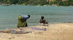 Malawi: poor people washing loundry in a lake Stock Footage