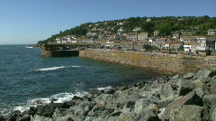 Mousehole harbour wall. Stock Footage